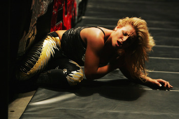 SYDNEY, AUSTRALIA - JUNE 15:  Natalya lays on the ground during WWE Smackdown at Acer Arena on June 15, 2008 in Sydney, Australia.  (Photo by Gaye Gerard/Getty Images)