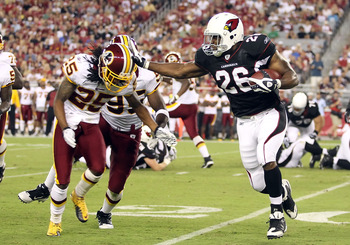 GLENDALE, AZ - SEPTEMBER 02:  Runningback Beanie Wells #26 of the Arizona Cardinals rushes the football against Chris Wilson #95 and Kevin Barnes #25 of the Washington Redskins during the first quarter of the preseason NFL game at the University of Phoeni