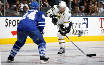 TORONTO - DECEMBER 23:   Jonas Frogren #24 of the Toronto Maple Leafs defends as Brad Richards #91 of the Dallas Stars takes a shot during their NHL game at the Air Canada Centre December 23, 2008 in Toronto, Ontario, Canada.  (Photo by Dave Sandford/Gett