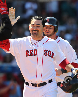 BOSTON, MA - JUNE 5:  Adrian Gonzalez #28 of the Boston Red Sox celebrates after connecting for a two-run home against the Oakland Athletics at Fenway Park on June 5, 2011 in Boston, Massachusetts.  (Photo by Jim Rogash/Getty Images)