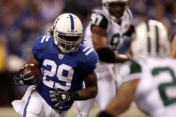 INDIANAPOLIS, IN - JANUARY 08:  Joseph Addai #29 of the Indianapolis Colts runs the ball against the New York Jets during their 2011 AFC wild card playoff game at Lucas Oil Stadium on January 8, 2011 in Indianapolis, Indiana.  The Jets won 17-16. (Photo b