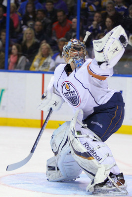 ST. LOUIS, MO - MARCH 24: Nikolai Khabibulin #35 of the Edmonton Oilers makes a save against the St. Louis Blues at the Scottrade Center on March 24, 2011 in St. Louis, Missouri.  (Photo by Dilip Vishwanat/Getty Images)