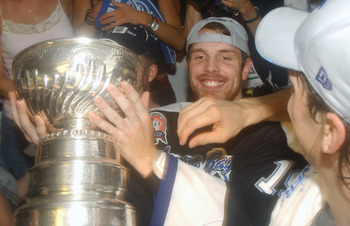 TAMPA, FL - JUNE 7:  Brad Richards #19 of the Tampa Bay Lightning smiles as he holds the Stanley Cup in the locker room after the victory over the Calgary Flames in Game seven of the NHL Stanley Cup Finals on June 7, 2004 at the St. Pete Times Forum in Ta