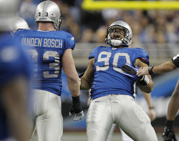 DETROIT - NOVEMBER 25:  Ndamukong Suh #90 of the Detroit Lions celebrates a first quarter sack next to Kyle Vanden Bosch #93 while playing the New England Patriots on November 25, 2010 at Ford Field in Detroit, Michigan.  (Photo by Gregory Shamus/Getty Im