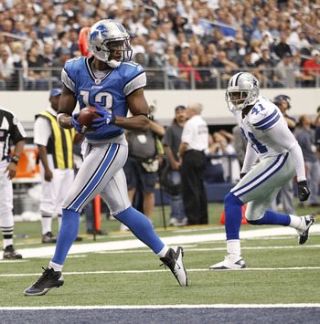 ARLINGTON, TX - NOVEMBER 21:  Nate Burleson #13 of the Detroit Lions scores a late second quarter touchdown as Terence Newman #41 of the Dallas Cowboys defends at Dallas Stadium on November 21, 2010 in Arlington, Texas.  (Photo by Leon Halip/Getty Images)