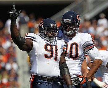 CHICAGO - SEPTEMBER 12: Tommie Harris #91 and Julius Peppers #90 of the Chicago Bears await the start of play against the Detroit Lions during the NFL season opening game at Soldier Field on September 12, 2010 in Chicago, Illinois. The Bears defeated the