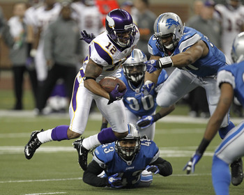 DETROIT, MI - JANUARY 02: Percy Harvin #12 of the Minnesota Vikings tries to escape the tackles of Ndamukong Suh #90, Nathan Vasher #30 and Eric King #43 of the Detroit Lions at Ford Field on January 2, 2011 in Detroit, Michigan.  (Photo by Gregory Shamus