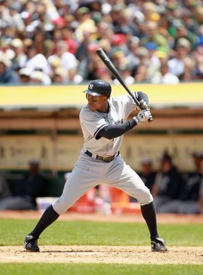 OAKLAND, CA - MAY 30:  Curtis Granderson #14 of the New York Yankees bats against the Oakland Athletics at Oakland-Alameda County Coliseum on May 30, 2011 in Oakland, California.  (Photo by Ezra Shaw/Getty Images)