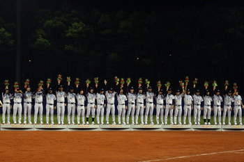 GUANGZHOU, CHINA - NOVEMBER 19:  Japan accepts their bronze medals after defeating China 6-2 at Aoti Baseball Field 1 during day seven of the 16th Asian Games Guangzhou 2010 on November 19, 2010 in Guangzhou, China.  (Photo by Richard Heathcote/Getty Imag