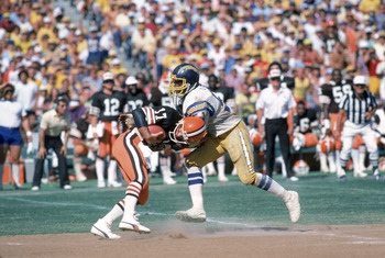 SAN DIEGO - SEPTEMBER 25:  Linebacker Woodrow Lowe #51 of the San Diego Chargers sacks quarterback Brian Sipe #17 of the Cleveland Browns during a game at Jack Murphy Stadium on September 25, 1983 in San Diego, California.  The Browns won 30-24.  (Photo b