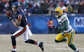 CHICAGO, IL - JANUARY 23:  Johnny Knox #13 of the Chicago Bears runs ahead of Tramon Williams #38 of the Green Bay Packers for a 32-yard gain in the fourth quarter in the NFC Championship Game at Soldier Field on January 23, 2011 in Chicago, Illinois.  (P