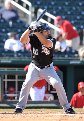 GOODYEAR, AZ - MARCH 02:  Carlos Quentin #20 of the Chicago White Sox gets ready in the batters box against the Cincinnati Reds during a spring training game at Goodyear Ballpark on March 2, 2011 in Goodyear, Arizona.  (Photo by Norm Hall/Getty Images)