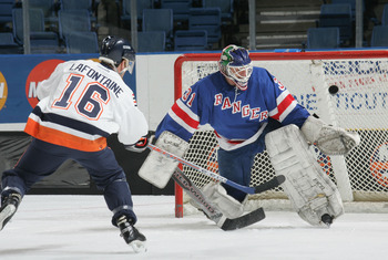 UNIONDALE, NY - APRIL 16:  Pat Lafontaine #16 of the New York Islanders Alumni scores on Mark Laforest #31 of the New York Ranger Alumni team during the Hockey for Heroes 3 on 3 Hockey Tournament on April 16, 2005 at Nassau Coliseum in Uniondale, New York