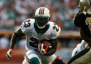 MIAMI - OCTOBER 25:  Running back Ronnie Brown #23 of the Miami Dolphins looks for room to run against the New Orleans Saints at Land Shark Stadium on October 25, 2009 in Miami, Florida.  (Photo by Doug Benc/Getty Images)
