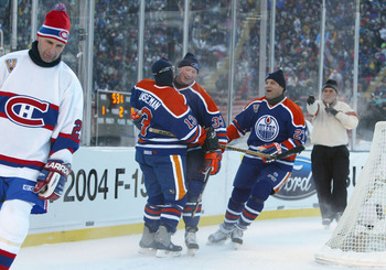 EDMONTON, CANADA - NOVEMBER 22:  Teammates Ken Linseman #13, Marty McSorley #33 and Dave Semenko #27 of the Edmonton Oilers celebrate a goal as Gaston Gingras (L) of the Montreal Canadiens skates away during the Molson Canadien Heritage Classic Megastars