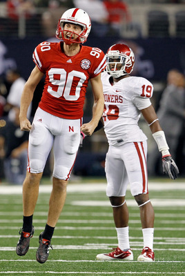 ARLINGTON, TX - DECEMBER 04:  Kicker Alex Henery #90 of the Nebraska Cornhuskers celebrates after kicking a field goal against the Oklahoma Sooners at Cowboys Stadium on December 4, 2010 in Arlington, Texas.  (Photo by Tom Pennington/Getty Images)