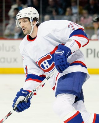 MONTREAL- MARCH 14:  Patrice Brisebois #71 of the Montreal Canadiens skates during the game against the New Jersey Devils at the Bell Centre on March 14, 2009 in Montreal, Quebec, Canada.  The Devils defeated the Canadiens 3-1.   (Photo by Richard Wolowic