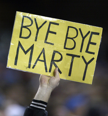 DETROIT- DECEMBER 29:  A fan holds up a sign expressing his feelings on Detroit Lions head coach Marty Mornhinweg during the last game of NFL regular season against the Minnesota Vikings at Ford Field on December 29, 2002 in Detroit, Michigan.  The Viking