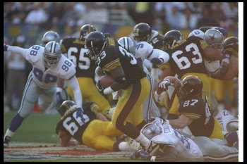 28 Jan 1996:   Running back Bam Morris of the Pittsburgh Steelers runs  as linebacker Godfrey Myles of the Dallas Cowboys tries to tackle him at Super Bowl XXX at Sun Devil Stadium in Tempe, Arizona.  The Cowboys won the game 27 - 17. Mandatory Credit: Ri