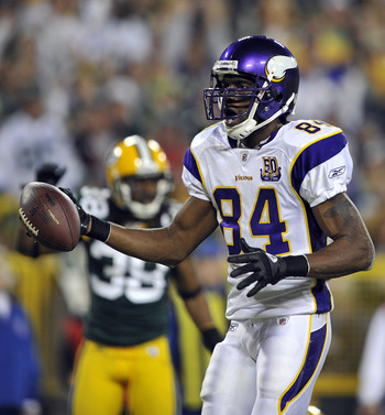 GREEN BAY, WI - OCTOBER 24:  Randy Moss #84 of the Minnesota Vikings celebrates a touchdown against the Green Bay Packers during their game at Lambeau Field on October 24, 2010 in Green Bay, Wisconsin. (Photo by Jim Prisching/Getty Images)