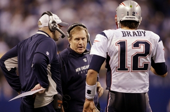 INDIANAPOLIS - NOVEMBER 15: Quarterback Tom Brady #12 of the New England Patriots speaks to head coach Bill Belichick in the fourth quarter of the game against the Indianapolis Colts at Lucas Oil Stadium on November 15, 2009 in Indianapolis, Indiana. The