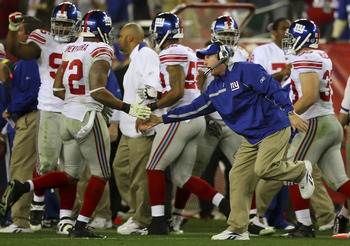 GLENDALE, AZ - FEBRUARY 03:  Head coach Tom Coughlin of the New York Giants congratulates Osi Umenyiora #72 during Super Bowl XLII against the New England Patriots on February 3, 2008 at the University of Phoenix Stadium in Glendale, Arizona.  (Photo by D