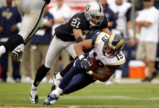 OAKLAND, CA - SEPTEMBER 19:  Laurent Robinson #19 of the St. Louis Rams is tackled by Nnamdi Asomugha #21 of the Oakland Raiders at the Oakland-Alameda County Coliseum on September 19, 2010 in Oakland, California.  (Photo by Ezra Shaw/Getty Images)