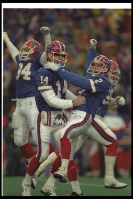 3 Jan 1993: Quarterback Frank Reich of the Buffalo Bills (left) celebrates with teammate kicker Steve Christie after a playoff game against the Houston Oilers at Rich Stadium in Orchard Park, New York. The Bills won the game in overtime, 41-38.