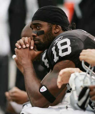 OAKLAND, CA - OCTOBER 01:  Randy Moss #18 of the Oakland Raiders looks on towards the end of the game against the Cleveland Browns on October 1, 2006 at McAfee Coliseum in Oakland, California. The Browns defeated the Raiders 24-21.  (Photo by Jonathan Fer
