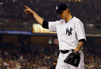 NEW YORK - MAY 21:  A.J. Burnett #34 of the New York Yankees salutes the crowd after being taken out of the game in the seventh inning against the New York Mets on May 21, 2011 at Yankee Stadium in the Bronx borough of New York City.  (Photo by Mike Stobe