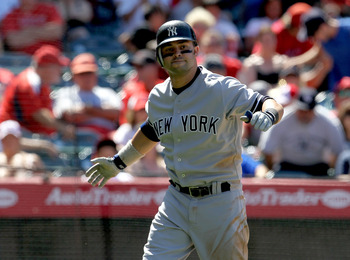ANAHEIM, CA - JUNE 05:  Nick Swisher #33 of the New York Yankees celebrates after hitting a solo home run in the eighth inning against the Los Angeles Angels of Anaheim on June 5, 2011 at Angel Stadium in Anaheim, California.  The Yankees won 5-3.  (Photo