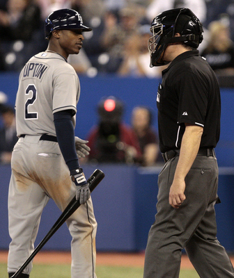 TORONTO, CANADA - MAY 18: B.J. Upton #2 of the Tampa Bay Rays argues a strike call with Tim Welke during MLB action against the Toronto Blue Jays at the Rogers Centre May 18, 2011 in Toronto, Ontario, Canada. (Photo by Abelimages/Getty Images)