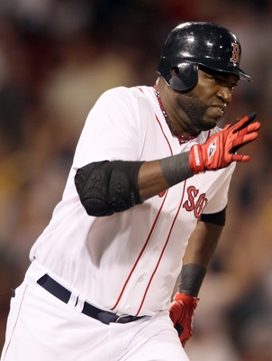 BOSTON, MA - MAY 31:  David Ortiz #34 of the Boston Red Sox heads around the bases after his three run homer in the eighth inning against the Chicago White Sox on May 31, 2011 at Fenway Park in Boston, Massachusetts.  (Photo by Elsa/Getty Images)