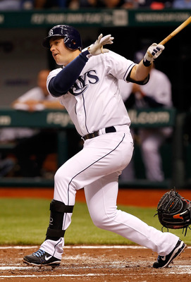 ST. PETERSBURG, FL - MAY 14:  Infielder Evan Longoria #3 of the Tampa Bay Rays fouls off a pitch against the Baltimore Orioles during the game at Tropicana Field on May 14, 2011 in St. Petersburg, Florida.  (Photo by J. Meric/Getty Images)