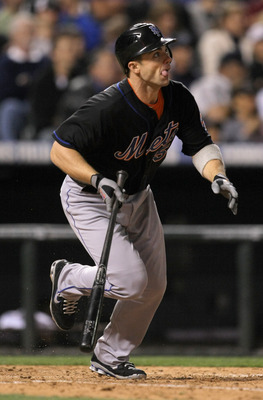 DENVER, CO - MAY 09:  Third baseman David Wright #5 of the New York Mets singles on a soft fly to rightfield off of pitcher Matt Belisle #34 of the Colorado Rockies in the seventh inning at Coors Field on May 9, 2011 in Denver, Colorado.  (Photo by Doug P