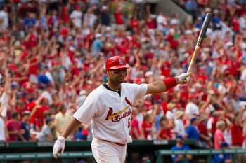 ST. LOUIS, MO - JUNE 5: Albert Pujols #5 of the St. Louis Cardinals celebrates his walk-off home run against the Chicago Cubs at Busch Stadium on June 5, 2011 in St. Louis, Missouri.  The Cardinals beat the Cubs 3-2 in 10 innings.  (Photo by Dilip Vishwan
