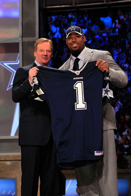 NEW YORK, NY - APRIL 28:  NFL Commissioner Roger Goodell (L) poses for a photo with Tyron Smith, #9 overall pick by the Dallas Cowboys, on stage during the 2011 NFL Draft at Radio City Music Hall on April 28, 2011 in New York City.  (Photo by Chris Trotma