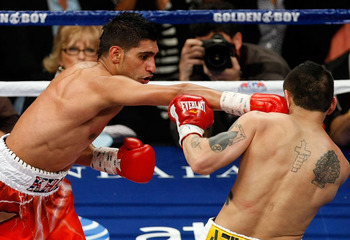 LAS VEGAS - DECEMBER 11:  (L-R) Amir Khan of England connects with a right to the face of Marcos Maidana of Argentina during the WBA super lightweight title fight at Mandalay Bay Events Center on December 11, 2010 in Las Vegas, Nevada.  (Photo by Ethan Mi