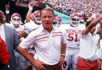 24 SEP 1988:  UNIVERSITY OF OKLAHOMA FOOTBALL COACH BARRY SWITZER LEADS HIS TEAM ON THE FIELD BEFORE THE SOONERS 23-7 LOSS TO THE USC TROJANS.  Mandatory Credit: Stephen Dunn/ALLSPORT
