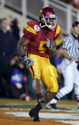 PASADENA, CA - JANUARY 04:  Reggie Bush #5 of the USC Trojans celebrates in the end zone after scoring a 26 yard touchdown in the fourth quarter of the BCS National Championship Rose Bowl Game against the Texas Longhorns at the Rose Bowl on January 4, 200