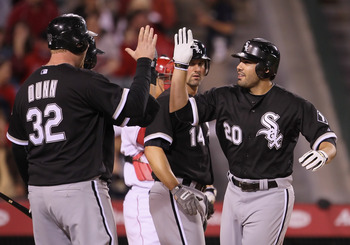 ANAHEIM, CA - MAY 09:  Carlos Quentin #20 and Adam Dunn #32 of the Chicago White Sox celebrate Quentin's three-run home run against the Los Angeles Angels of Anaheim in the seventh inning at Angel Stadium of Anaheim on May 9, 2011 in Anaheim, California.