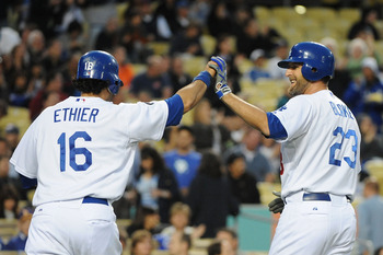 LOS ANGELES, CA - APRIL 20:  (L-R) Andre Ethier #16 celebrates with teammate Casey Blake #23 of the Los Angeles Dodgers after hitting a two run homerun in the first inning against the Atlanta Braves at Dodger Stadium on April 20, 2011 in Los Angeles, Cali