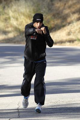 LOS ANGELES, CA - MAY 25:  Amir Khan runs in the Hollywood Hills wearing Reebok ZigTech apparel and footwear at Griffith Park on May 25, 2011 in Los Angeles, California. The light-welterweight World Champion began training this week in Los Angeles for his