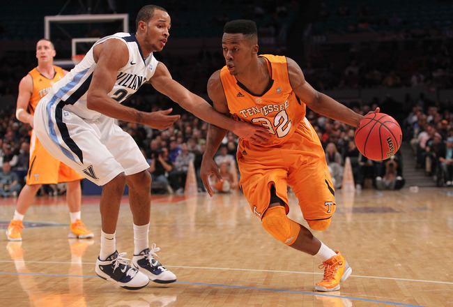 NEW YORK - NOVEMBER 26: Scotty Hopson #32 of the Tennessee Volunteers drives to the basket against Dominic Cheek #23 of the Villanova Wildcats  during the Championship game at Madison Square Garden on November 26, 2010 in New York City.  (Photo by Nick La