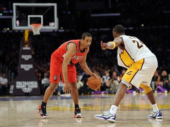 LOS ANGELES, CA - MARCH 20:  Andre Miller #24 of the Portland Trail Blazers faces off against Kobe Bryant #24 of the Los Angeles Lakers at the Staples Center on March 20, 2011 in Los Angeles, California.  NOTE TO USER: User expressly acknowledges and agre