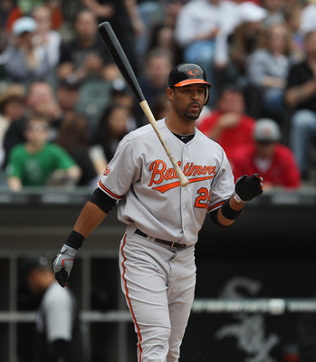 CHICAGO, IL - MAY 01: Derrek Lee #25 of the Baltimore Orioles throws his bat after striking out against the Chicago White Sox at U.S. Cellular Field on May 1, 2011 in Chicago, Illinois. The Orioles defeated the White Sox 6-4. (Photo by Jonathan Daniel/Get
