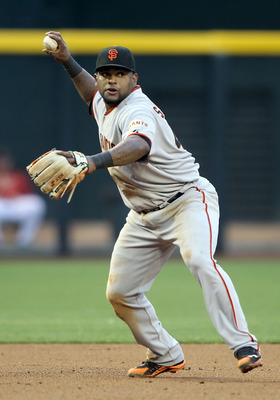 PHOENIX, AZ - APRIL 16:  Infielder Pablo Sandoval #48 of the San Francisco Giants fields a ground ball out during the Major League Baseball game against the Arizona Diamondbacks at Chase Field on April 16, 2011 in Phoenix, Arizona.  The Giants defeated th