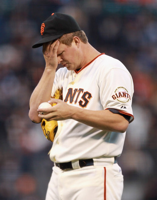 SAN FRANCISCO, CA - MAY 24:  Matt Cain #18 of the San Francisco Giants reacts after giving up three runs to the Florida Marlins in the third inning at AT&T Park on May 24, 2011 in San Francisco, California.  (Photo by Ezra Shaw/Getty Images)