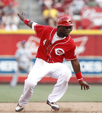 CINCINNATI, OH - JUNE 4: Brandon Phillips #4 of the Cincinnati Reds tries to keep his balance after rounding second base against the Los Angeles Dodgers at Great American Ball Park on June 4, 2011 in Cincinnati, Ohio. The Dodgers won 11-8 in eleven inning