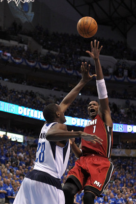 DALLAS, TX - JUNE 05:  Chris Bosh #1 of the Miami Heat attempts a shot against Ian Mahinmi #28 of the Dallas Mavericks in Game Three of the 2011 NBA Finals at American Airlines Center on June 5, 2011 in Dallas, Texas.  NOTE TO USER: User expressly acknowl